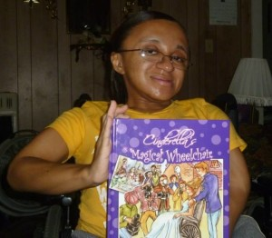 "Me proudly holding ""Cinderella's Magical Wheelchair"" by Jewel Kats."
