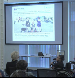 Image of Vilissa speaking to audience members at the Disability & Intersectionality Summit.