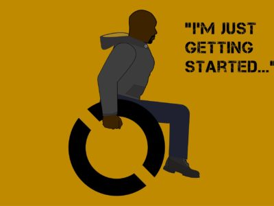 "Dark yellow mustard background with Luke Cage in a wheelchair. The following words are in the upper right of the image: ""I'm just getting started"""